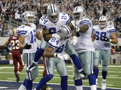 Miles Austin (#19), Marion Barber (#24), Doug Free (#68), Alton Guode (second from right)